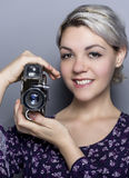 Film Student Holding a Vintage Camera Royalty Free Stock Photography