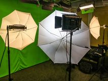 Film studio,, green background, video production, production, filming, film, video advertising. Modern film studio, lighting, green background umbrellas stock photography