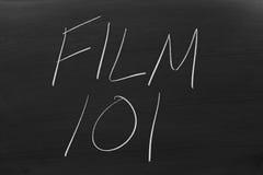 Film 101 sur un tableau noir Photos stock