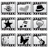 Film with symbols. Grunge style film with symbols vector Stock Images