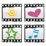 Film with symbols. Four different symbols vector. sun, heart, star and note Stock Photography