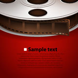 Film tape on red background. Cinema concept Stock Photos