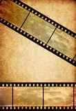 Film tape on vintage old paper background Stock Photo