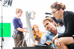 Free Film Team Discussing Direction For Video Production Royalty Free Stock Images - 36566169
