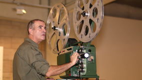Film Technician Projecting 16mm Film stock footage