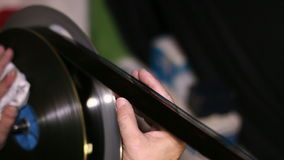 Film Technician Rewinding and Checking 35mm Film stock video