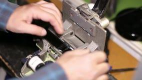 Film Technician Splicing 35mm Film stock video
