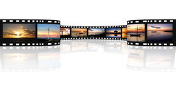 Film on a white. With reflex Royalty Free Stock Photo