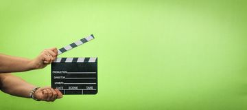 Filma produktion, clapperen, rollbesättning, chromatangenten, direktör, arkivfoto
