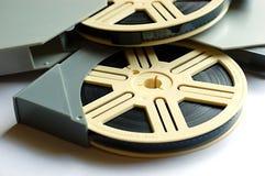 Filmbandspulen auf weißem Hintergrund stockbilder