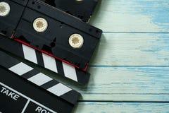 Filmclapper och videokassettband royaltyfri fotografi