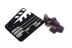 Filmclapperbräde och 35mm film Royaltyfria Foton