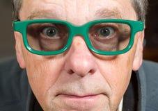 Filme de observação do homem superior com vidros 3d Foto de Stock Royalty Free