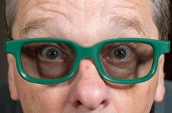 Filme de observação do homem superior com vidros 3d Fotografia de Stock