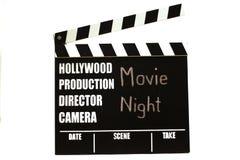Filmen kritiserar - filmclapperboard Filmnatt som titel royaltyfri foto