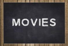 Filmer - text på den svart tavlan Arkivbilder