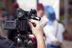 Filmer un événement avec une caméra vidéo Image stock