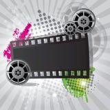 Filmhintergrund mit Filmbandspule und Filmstreifen Stockfoto