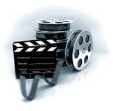 Filmi l'ardesia con la bobina di pellicola di film Immagine Stock