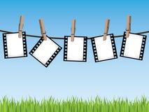 Filmi le strisce che appendono su una riga Fotografia Stock Libera da Diritti