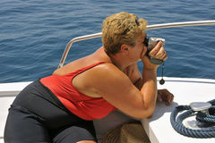 Filming. Tourist on a motorboat filming during a summer ride Royalty Free Stock Photography