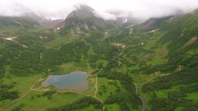 Filming from the air of the mountains and lakes. Kamchatka stock video