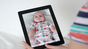 Filming baby with digital tablet Stock Photos