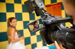 Filming the bride. Video filming of a bride on a checkered background Stock Image
