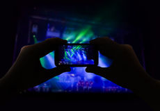 Filming a concert. Man filming a concert with your mobile phone No person Royalty Free Stock Photography