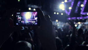Filming concert on a phone stock video