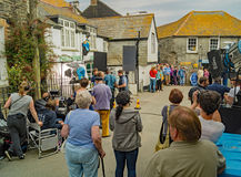 Filming of Doc Martin at Port Isaac. Port Isaac England 11 June 2015 A crowd of tourists and day trippers watch preparations for another scene for Doc Martin Stock Photography