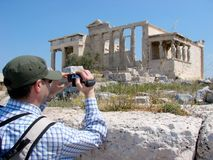 Filming the Erecthion in Athens. A man filming the Erechtion on the Acropolis of Athens Stock Images