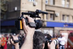 Filming an event with a video camera Stock Image