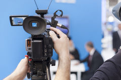 Filming an event with a video camera Stock Photos