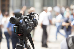 Filming an event with a video camera. Covering an event with a video camera Royalty Free Stock Image