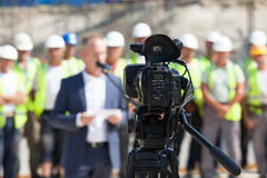 Filming an event with a video camera Royalty Free Stock Photo