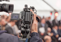 Filming an event with a video camera Royalty Free Stock Photography