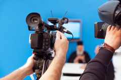 Filming an event with a video camera Royalty Free Stock Images