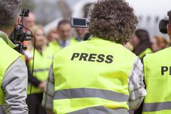 Filming an event with a video camera. News conference. Royalty Free Stock Image