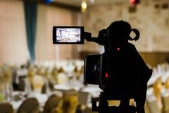 Filming of the event. Videography. Served tables in the Banquet hall.  Stock Photos