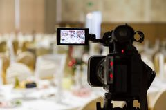 Filming of the event. Videography. Served tables in the Banquet hall.  Royalty Free Stock Image