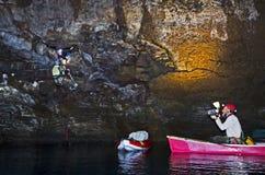 Filming Exploration Of Lava Tube Lake Cave Stock Image