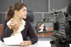 Filming Female Reporter in a Set Stock Photos
