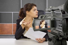 Filming Female Reporter in a Set Royalty Free Stock Photography