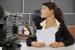 Filming Female Reporter in a Set Stock Photo