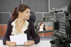 Filming Female Reporter in a Set Royalty Free Stock Photos