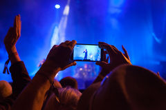 Filming at a Gig Royalty Free Stock Photo