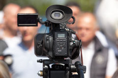 Filming an media event with a video camera Stock Photography