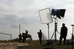 Filming of the new movie The Knights. MILOVICE, CZECH REPUBLIC - OCTOBER 23, 2013: Actor dressed as a medieval knight rides a horse during the filming of the new royalty free stock photos