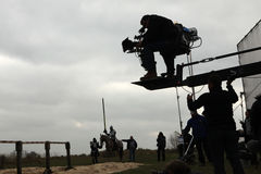 Filming of the new movie The Knights. MILOVICE, CZECH REPUBLIC - OCTOBER 23, 2013: Actor dressed as a medieval knight rides a horse during the filming of the new royalty free stock photography